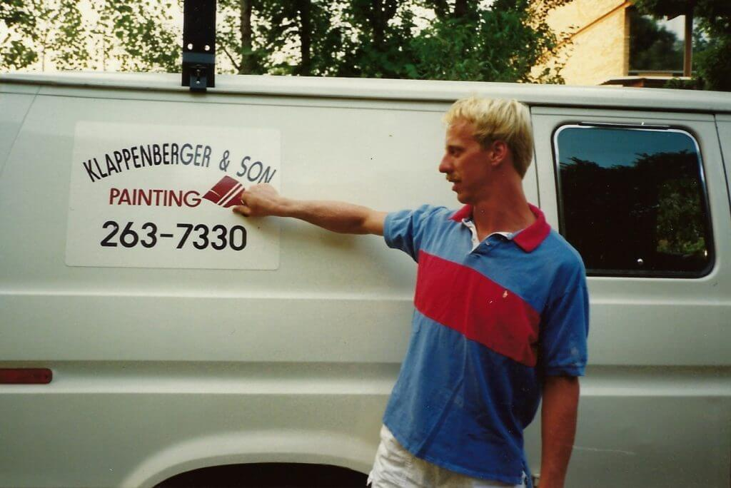 David Klappenberger back in 1990 when he started his painting company and is standing by his first van