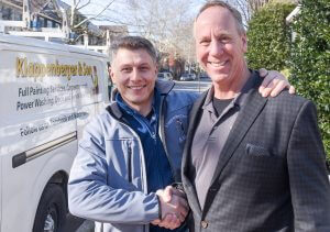 Franchisee and Franchisor shaking hands smiling